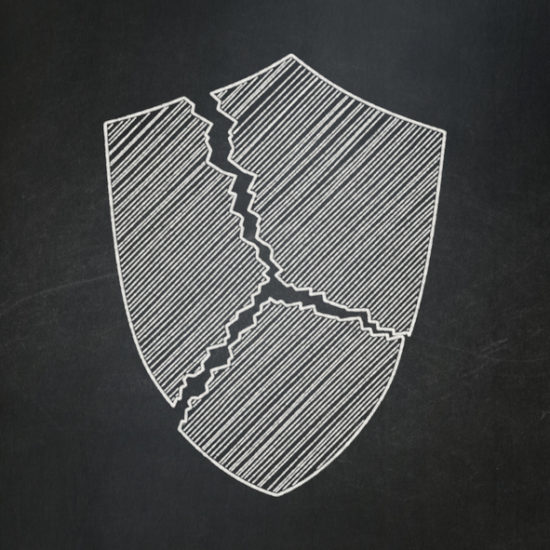 Privacy concept: Broken Shield on chalkboard background